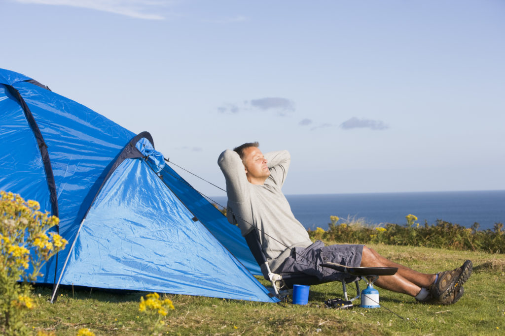 Auto Insurance Online >> Man relaxing outside of tent - South Easthope Mutual Insurance